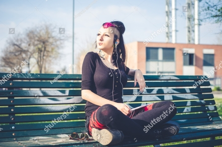 stock-photo-young-beautiful-punk-dark-girl-using-tablet-in-urban-landscape-193332707.jpg